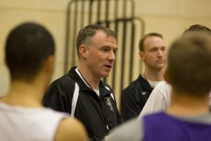 Coach John Tauer discusses the blueprint of the Calvin College offense and defense during practice Monday. Two games into the NCAA tournament, the Tommies tenacious defense has allowed opponents to average only sixty points a game. (Jesse Krull/TommieMedia)