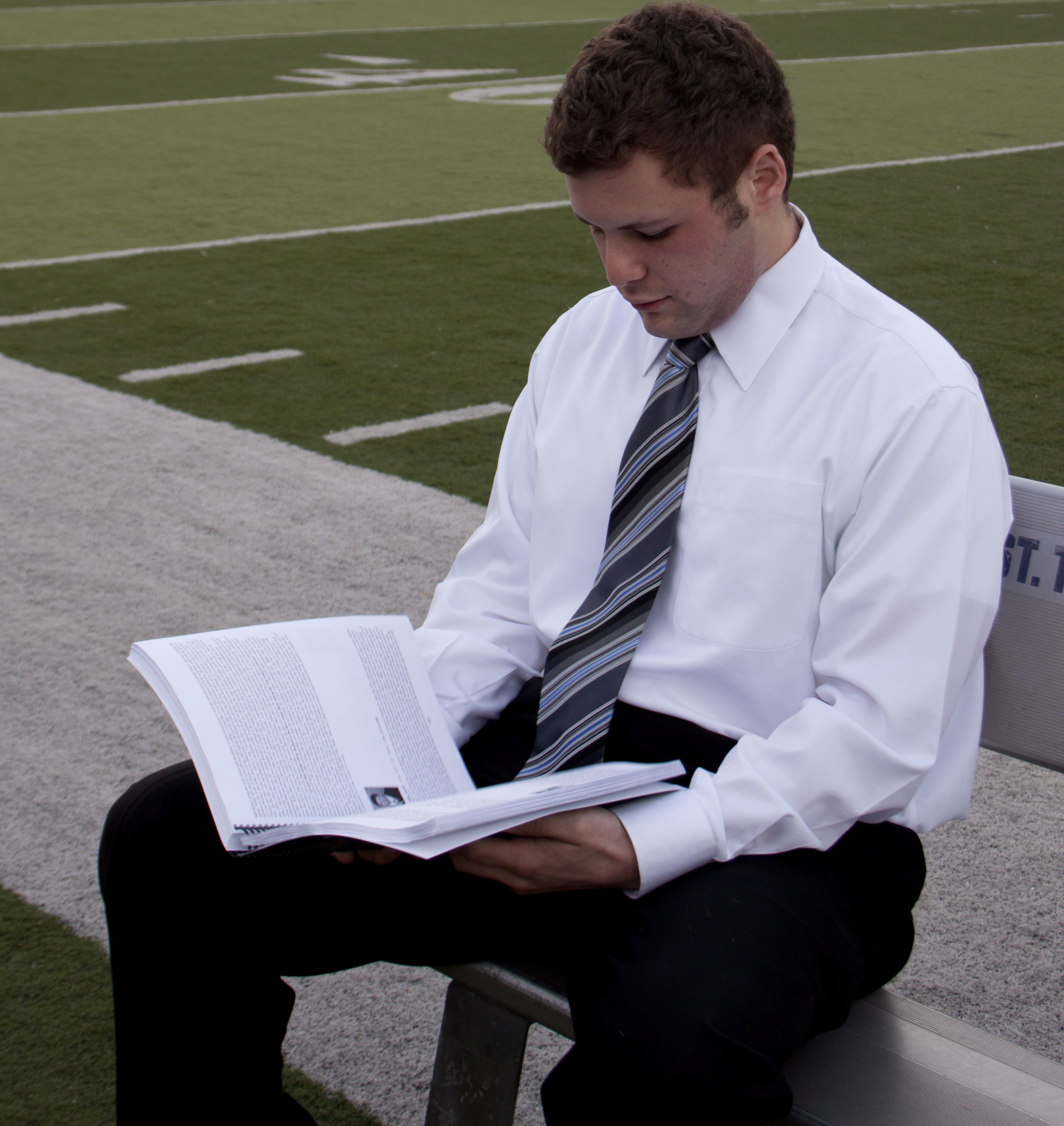 "Shawn Zobel looks at a player profile in his ""2012 Draft Preview."" Zobel completed the book, which includes analysis of 255 college football players. (Heidi Enninga/TommieMedia)"