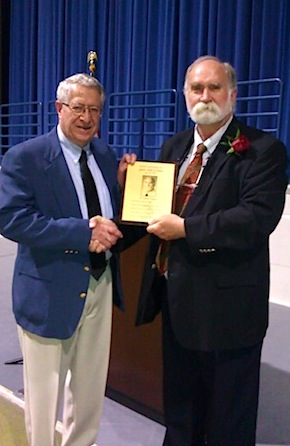<p>Swimming coach Tom Hodgson receives his Rochester Quarterbacks Club Hall of Fame plaque at the induction ceremony Monday night. (Photo courtesy of Tom Hodgson)</p>