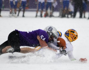 <p>Former St. Thomas linebacker Tony Danna makes a tackle against St. Scholastica in last year's NCAA playoffs. (Rita Kovtun/TommieMedia)</p>
