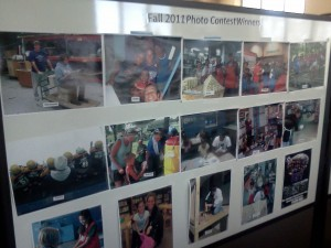 This board displays the Top 15 pictures from fall semester of students who were exempt from having to present their final project. (Kristopher Jobe/TommieMedia)
