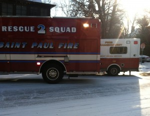 <p>Rescue vehicles idle at the corner of Cleveland and Selby, where the father of a St. Thomas student slipped and was injured in a fall Monday morning. (Alyssa Adkins/TommieMedia)</p>