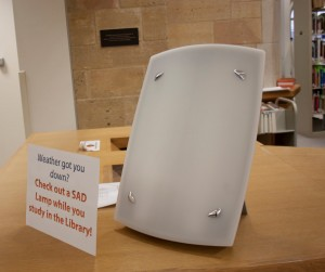 <p>A SAD lamp sits on the front desk in the O'Shaughnessy-Frey Library. While the library used to have the SAD lamp sitting at a table open for students to use, they recently implemented a checkout process to create a more flexible and mobile system for users. (Gabrielle Martinson/TommieMedia)</p>