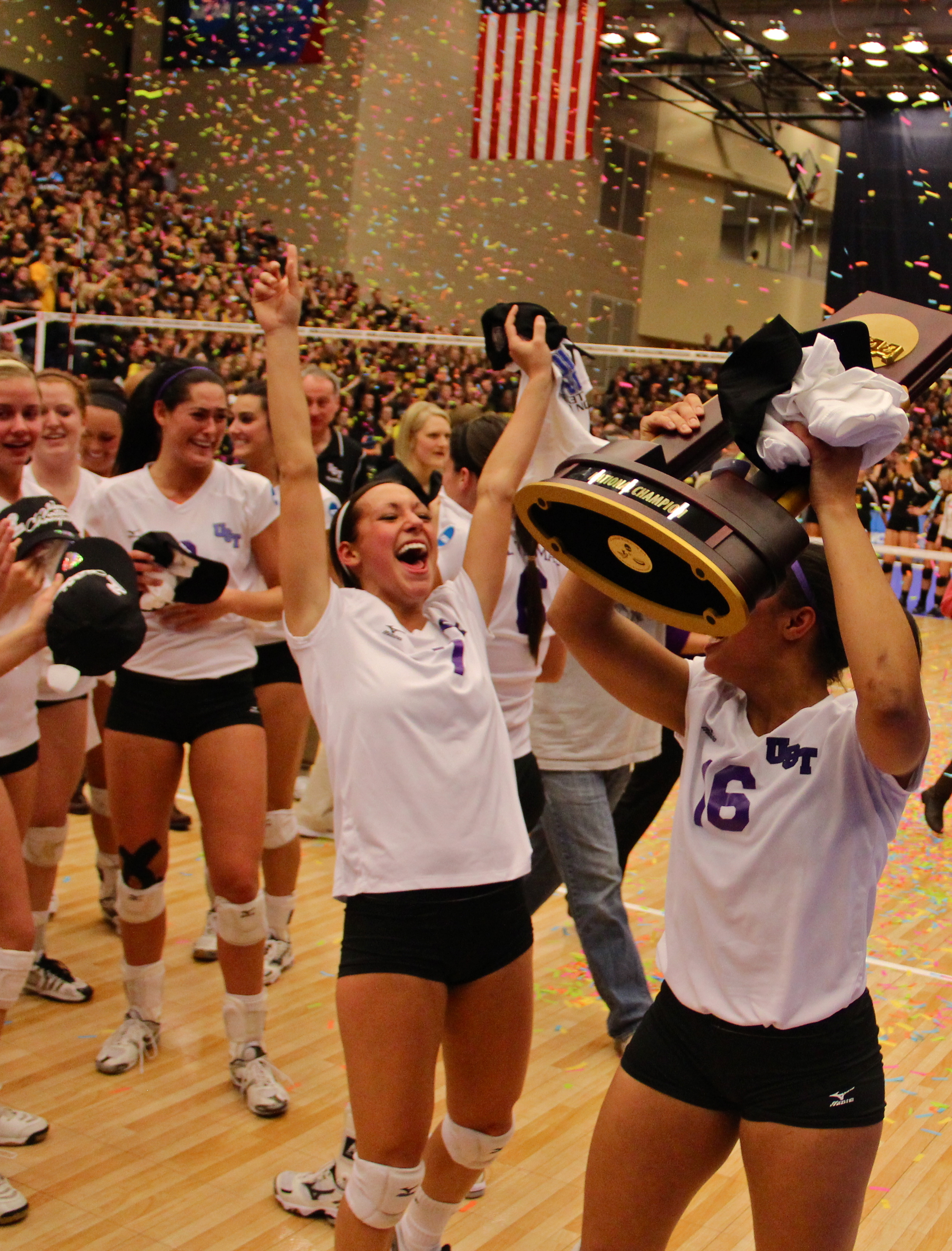 Setter Katie Maher celebrates as the St. Thomas volleyball team is presented the national championship trophy after a tight, 3-2 victory over the Calvin Knights in November 2012. The Tommies were given the No. 1 preseason ranking by the American Volleyball Coaches Association poll Wednesday. (Rosie Murphy/TommieMedia)