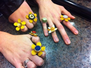 <p>Junior Lindsey Landgraf and sophomores Jesse Stone and Mariann Kukielka sport their own creations. Every piece of fruit jewelry is hand-crafted and made from lemons and limes. (Stephanie Dodd/TommieMedia)</p>