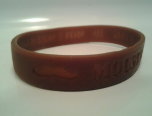 "<p>The official Movember bracelets are stamped with ""Moustache is King."" Vaughan signed up with the Movember group two years ago and handed bracelets out throughout the month. (Anastasia Strayley/TommieMedia)</p>"