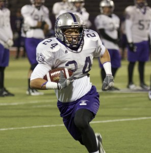 <p>Running back Brenton Braddock carries the ball at practice Tuesday in preparation for Saturday's game against Hobart. Braddock needs 86 yards to reach 1,000 rushing yards for the season. (Ross Schreck/TommieMedia)</p>
