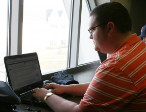 <p>Senior Jake Cordes checks his email in the Anderson Student Center Wednesday. Cordes is one of the youngest officeholders in Minnesota after being elected to the Farmington school board in November. (Gabrielle Martinson/TommieMedia)</p>