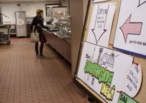 <p>A student orders lunch at the Binz Refectory on South Campus. The Southside Deli, opening spring 2013, will wrap around the back of the main entrée line. (Laura Landvik/TommieMedia)</p>