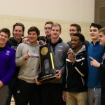 Members of the men's basketball team pose with the national championship trophy. St. Thomas won the national title in Salem, Virginia on March 19. (Meghan Vosbeek/TommieMedia)
