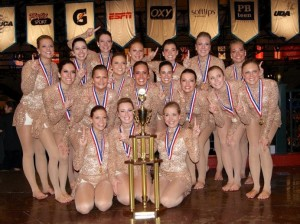 <p>The dance team poses with their national first place trophy for the Universal Dance Association's open jazz category. The win marked the team's first consecutive title in the open jazz category from last season to this season. (Photo courtesy of the St. Thomas dance team)</p>