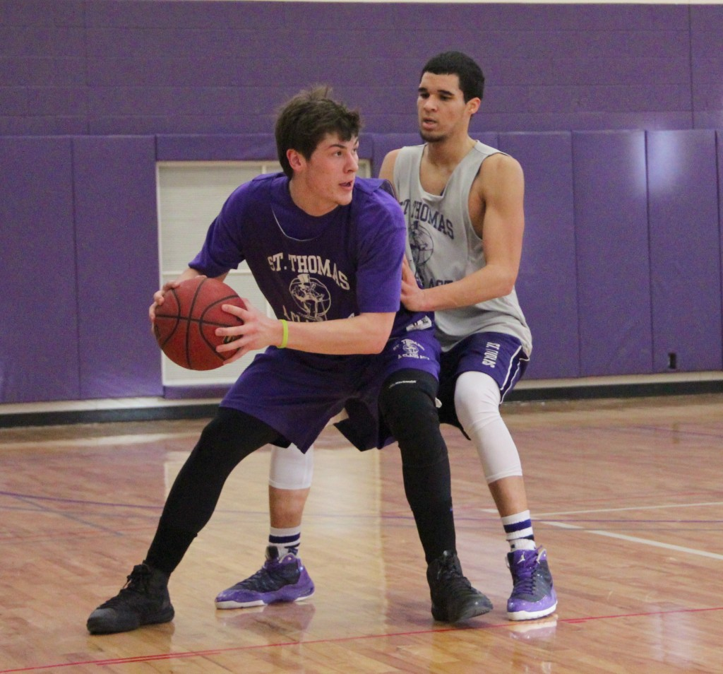 Taylor Montero holds off a defender during practice. Montero returned from a torn ACL in 2011 and is averaging 13.7 minutes per game for the Tommies. (Eden Checkol/TommieMedia)