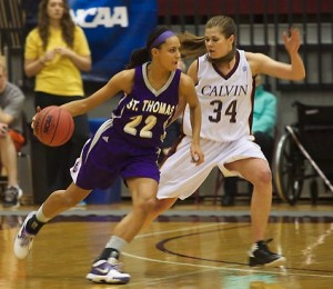<p>Forward Taylor Young looks to drive past foward Courtney Kurncz in last season's Elite Eight game. The Tommies defeated the Knights in overtime, earning a spot in the Final Four. (Cynthia Johnson/TommieMedia)</p>