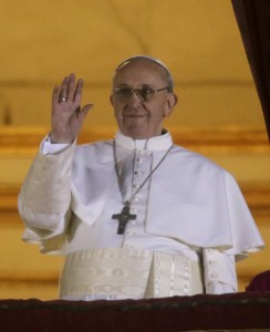 <p>Pope Francis waves to the crowd from the central balcony of St. Peter's Basilica at the Vatican, Wednesday, March 13, 2013. Cardinal Jorge Bergoglio who chose the name of Francis is the 266th pontiff of the Roman Catholic Church. (AP Photo/Gregorio Borgia)</p>