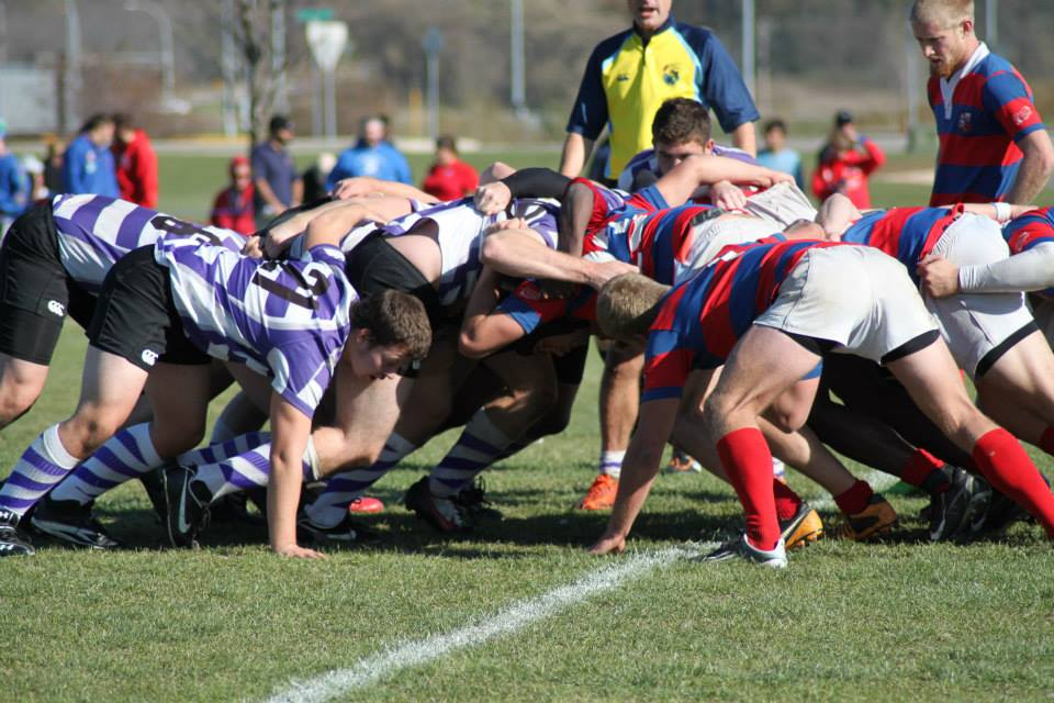 The University of St. Thomas Rugby club clashes with St. John's in the scrum. Rugby has expanded out of the collegiate scene, becoming the fastest growing team sport in the United States. (Photo courtesy of Catie Berens)