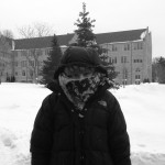 Senior Caroline Regan braves the cold on campus by bundling up in her warmest winter gear. (Anne Gaslin/TommieMedia)