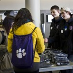 Junior class senators Ryan Smith and Evan Eklund distribute mittens to Tommie Talk attendees. Smith said he hoped to educate people about Undergraduate Student Government at the event. (Grace Pastoor/TommieMedia)