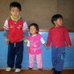 Three children play in Casa Cuna, one of the Working Boys Center's daycares. The organization serves about 2,000 people in Quito, Ecuador every day, according to its website. (Photo courtesy of Abby Anderson)