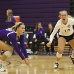 Defensive specialist Jennifer Wild dives for the ball as outside hitter Audrey Erickson looks on. St. Thomas lost 3-1 to St. Ben's on Wednesday. (Tom Pitzen/TommieMedia)