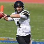 St. Olaf quarterback Jack Goldstein looks for a receiver Saturday against Carleton. Goldstein passed for 328 yards to help the Oles take their first MIAC victory of the season.