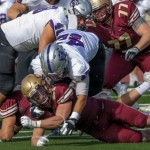 St. Thomas defensive lineman Anthony King-Foreman tackles fullback Chad Johnson. The Tommies defeated the Cobbers 23-20 on Saturday. (Carlee Hackl/TommieMedia)