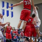 UW River Falls forward Brennan Witt leaps toward the basket for a rebound. St. Thomas took on UW River Falls Tuesday night in St. Paul. (Carlee Hackl/TommieMedia)