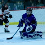Goalie Kenzie Torpy blocks a shot by River Falls. Torpy had 18 saves during Friday's game. (Natalie Hall/TommieMedia)