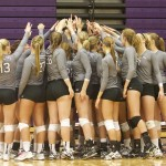The St. Thomas volleyball team gathers before a match against St. Mary's earlier this season. The women secured their 10th consecutive NCAA appearance by defeating Augsburg Saturday. (Madeleine Davidson/TommieMedia)