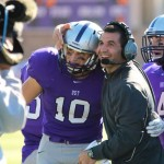 Coach Glenn Caruso embraces wide receiver Pete Fitzsimmons after a Tommie touchdown during last year's game against Augsburg. The Tommies will face the Auggies Saturday at Edor Nelson Field.  (Carlee Hackl/TommieMedia)
