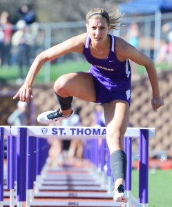 Senior All-American Mallory Burnham focuses over a hurdle in 2013's preliminaries. This year, Burnham advances to Saturday's finals in three events. (Whitney Abrahamson/TommieMedia)