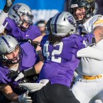 Oshkosh offensive lineman Austin Haase blocks St. Thomas defensive lineman Anthony King-Foreman. St. Thomas committed eight turnovers -- five interceptions and three fumbles -- on Saturday. (Carlee Hackl/TommieMedia)