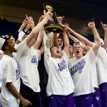 The Tommies bask in glory with the championship trophy. (Lauren Andrego/TommieMedia)