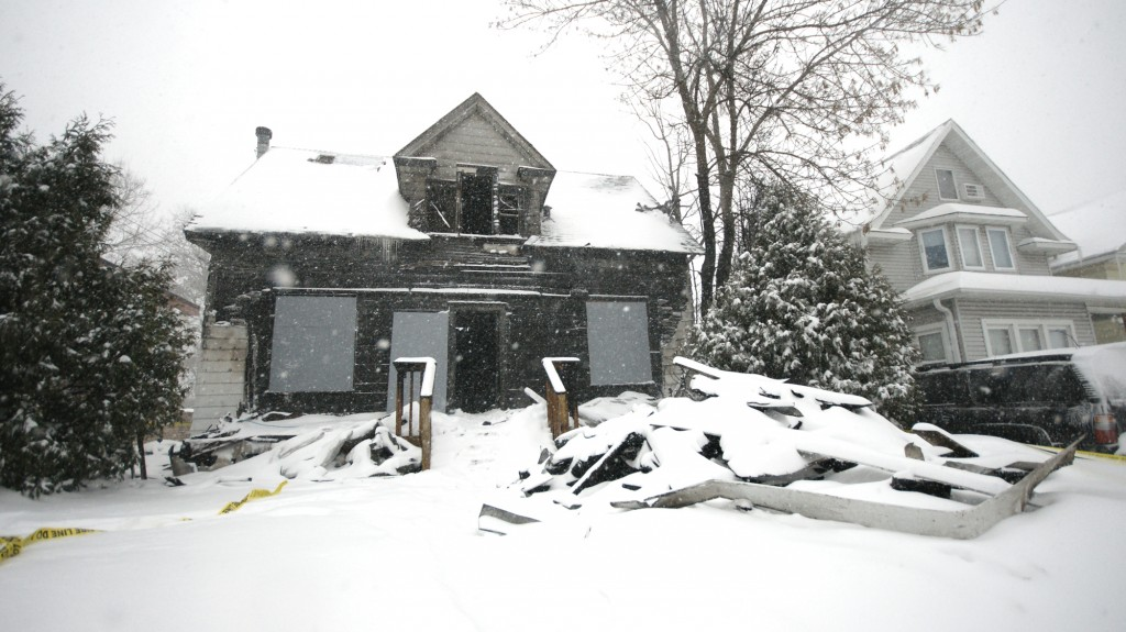 <p>The house, located at 1795 Selby Ave., was engulfed in flames when firefighters arrived. (John Kruger/TommieMedia)</p>