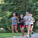 The St. Thomas women's track team runs along the river during practice. Mississippi River Boulevard is a well-known running route for students. (Miranda Lockner/TommieMedia)