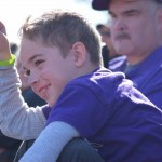 A young fan cheers on his uncle, St. Thomas center Stefan Sauer. Sauer and the offensive line paved the way for 595 total yards for the Tommies. (Miranda Lockner/TommieMedia)
