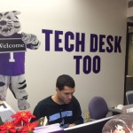 A student works at the ITS desk in the lower level of OEC. ITS has taken advantage of the summer lull and made many tech changes around campus.