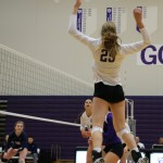 Outside hitter Brooke Reichart leaps to spike the ball over the net during the fourth set. Reichart had 18 kills against the Carleton Knights. (Natalie Hall/TommieMedia)