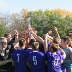 The team hoists its conference championship trophy. The Tommies earned an automatic berth to the NCAA tournament with the win. (Spencer Flaten/TommieMedia file photo)