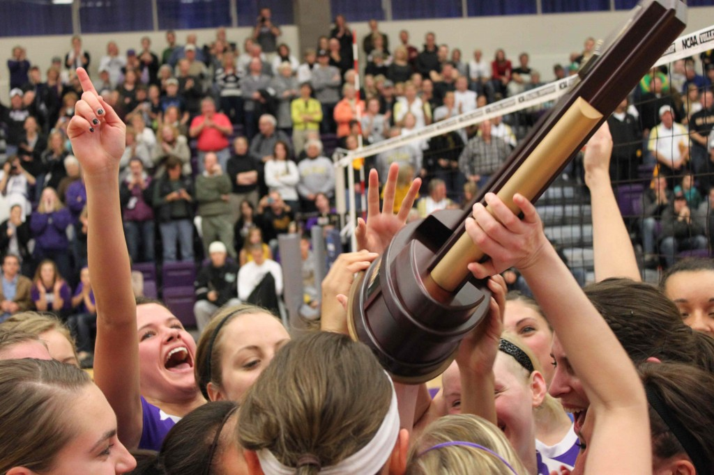 St. Thomas raises up the regional championship trophy and celebrates earning the first trip to the national tournament in school history. (Jordan Osterman/TommieMedia)