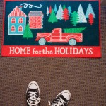 "A welcome mat reading, ""Home for the Holidays"" lays outside a dorm room. Many welcome mats were placed outside of individual dorm rooms in Dowling Hall. (Meghan Vosbeek/TommieMedia)"