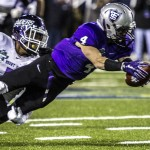 Wide receiver Jack Gilliland dives for extra yards after catching a pass. St. Thomas is tied with Mt. Union 14-14 at halftime of the Stagg Bowl. (Andrew Brinkmann/TommieMedia)