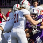Running back Jack Kaiser runs into a wall of St. John's defenders. St. John's defeated St. Thomas 24-14 Saturday at O'Shaughnessy Stadium. (Jake Remes/TommieMedia)