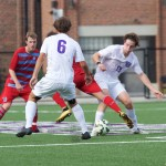 A Tommie and Johnnie skirmish for the ball as midfielder Amos Nash and Bottum begin to steal the ball. St. Thomas fell to St. John's 2-1 in overtime Wednesday. (Eric Bromback/TommieMedia)
