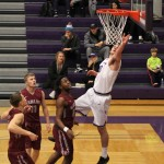 Junior Ryan Boll goes up strong for a layup. Boll lead the Tommies with 21 points against Hamline Wednesday night.  (Ben Burke/TommieMedia)
