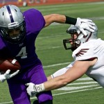 Wide receiver Jack Gilliland stiff-arms a Wisconsin-La Crosse defender during last year's 46-0 win. The Tommies will take on the Eagles Saturday at O'Shaughnessy Stadium. (Jake Remes/TommieMedia)