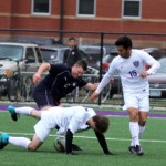 Defender Johnny Mulvahill dodges the ball while tumbling to the ground. Despite a bold effort, the Tommies lost 1-0 in double overtime. (Miranda Lockner/TommieMedia)