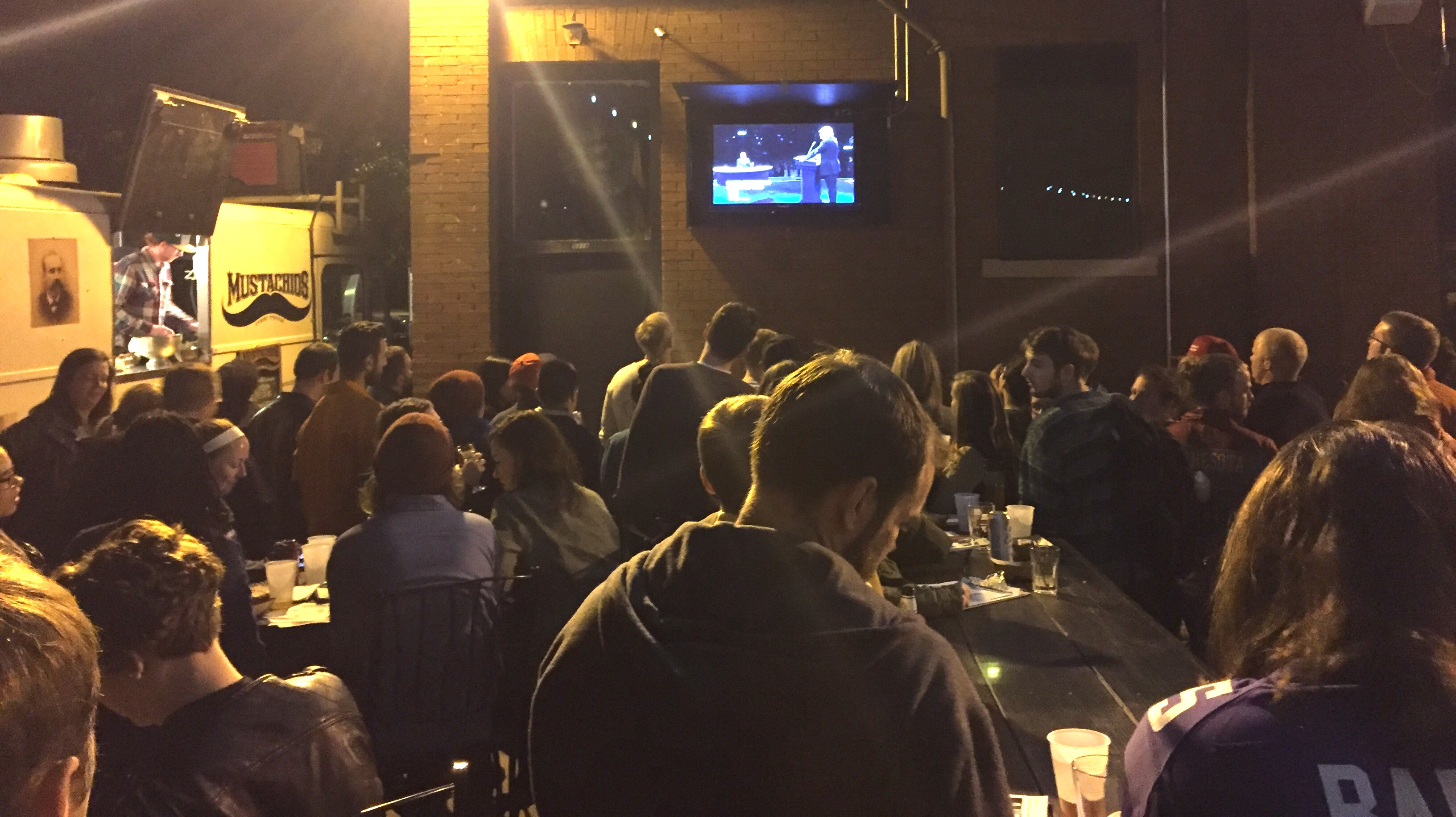 Community gathers at debate watch party