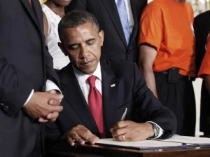 <p>President Obama signing the bill that saves students from rising loan interest rates (Photo courtesy of Pablo Martinez Monsivais/Associated Press) </p>