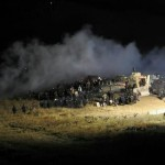 n this image provided by Morton County Sheriff's Department, law enforcement and protesters clash near the site of the Dakota Access pipeline on Sunday, Nov. 20, 2016, in Cannon Ball, N.D. The clash came as protesters sought to push past a bridge on a state highway that had been blockaded since late October, according to the Morton County Sheriff's Office. (Morton County Sheriff's Department via AP)