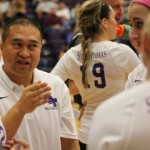 Coach Thanh Pham stares intently at his players from the sidelines of a game earlier this season. The St. Thomas volleyball team played the season's last game Saturday. (Tom Pitzen/TommieMedia)